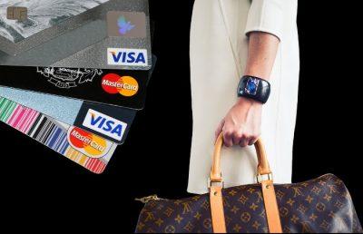 Karty kredytowe Mastercard i Visa - kobieta z torbą Louis Vuitton na zakupach